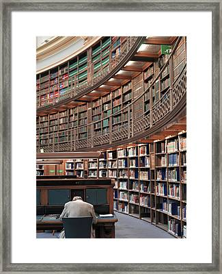 A Man Studies In The Library Framed Print by Justin Guariglia