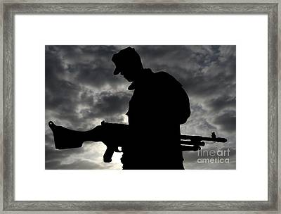 A Marine Attaches An M-240g Medium Framed Print