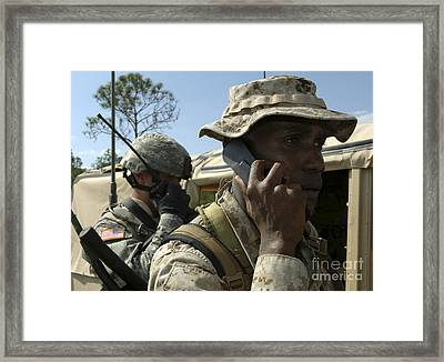A Marine Communicates With Aircraft Framed Print by Stocktrek Images