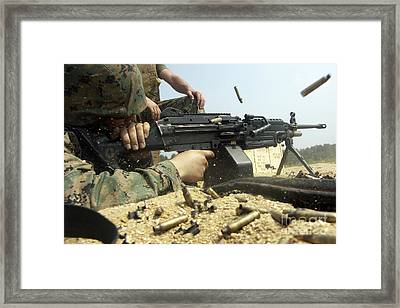 A Marine Engages Targets With An M-249 Framed Print