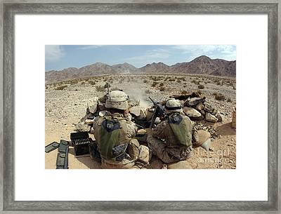 A Marine Fires His M2 .50 Caliber Heavy Framed Print