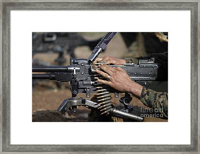 A Marine Loads A M-240g Machine Gun Framed Print