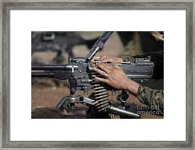 A Marine Loads A M-240g Machine Gun Framed Print by Stocktrek Images