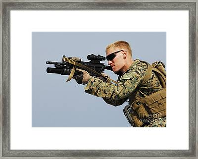 A Marine Looks Through The Sight Framed Print by Stocktrek Images