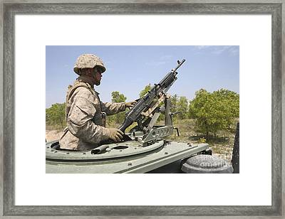 A Marine Prepares To Fire His M240 Framed Print by Stocktrek Images