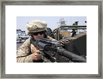 A Marine Scans The Horizon Framed Print by Stocktrek Images