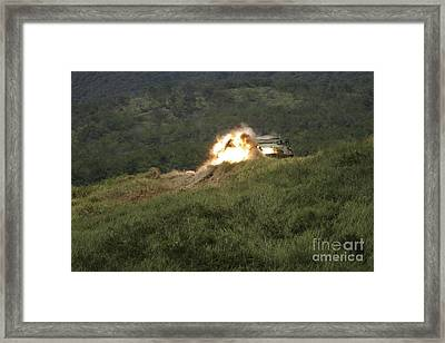 A Marine Scores A Direct Hit While Framed Print by Stocktrek Images