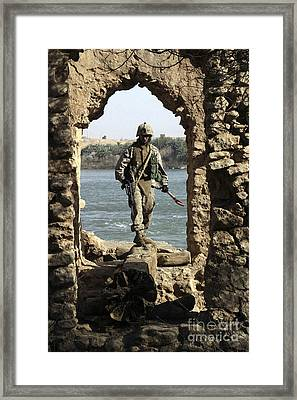 A Marine Searching A Stone Aqueduct Framed Print by Stocktrek Images
