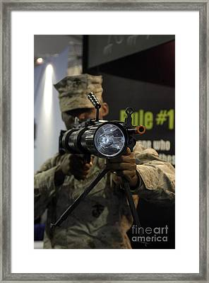 A Marine Tests The Night Hunter II Framed Print by Stocktrek Images