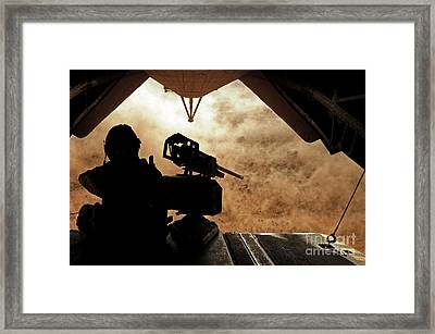 A Marine Waits For Dust To Clear While Framed Print by Stocktrek Images
