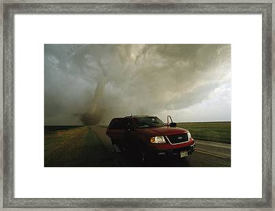A Massive F4 Category Tornado Rampages Framed Print by Carsten Peter