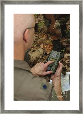 A Member Of The 130th Airlift Wing Framed Print by Stocktrek Images