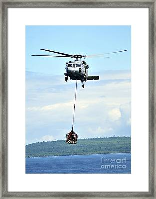 A Mh-60 Knighthawk Carries Supplies Framed Print by Stocktrek Images