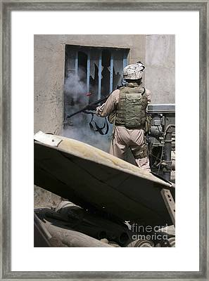 A Military Policeman Uses A Breaching Framed Print by Stocktrek Images
