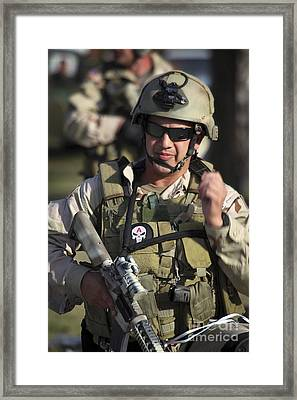 A Military Reserve Navy Seal Gives Framed Print by Michael Wood