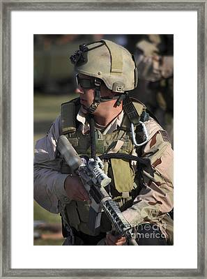 A Military Reserve Navy Seal Kneels Framed Print by Michael Wood