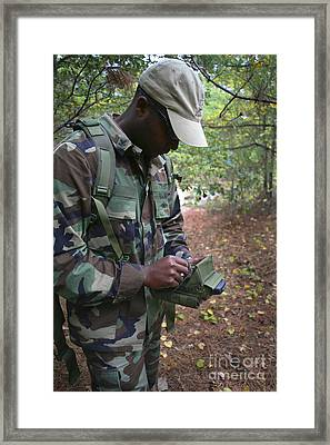 A Military Technician Uses A Pda Framed Print by Michael Wood