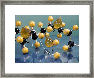 A Model Of An Oil Molecule Is Set Framed Print by B. Anthony Stewart