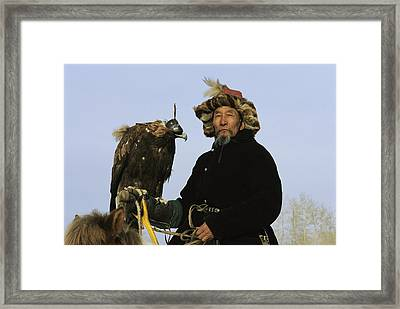 A Mongolian Eagle Hunter In Kazakhstan Framed Print by Ed George