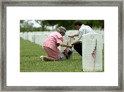 A Mother And Her Son Hold Hands Framed Print