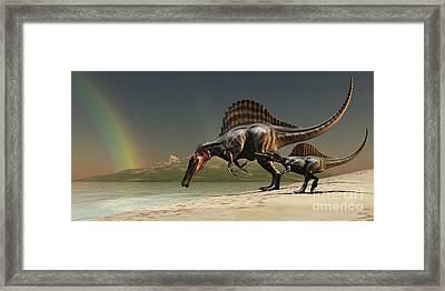 A Mother Spinosaurus Brings Framed Print