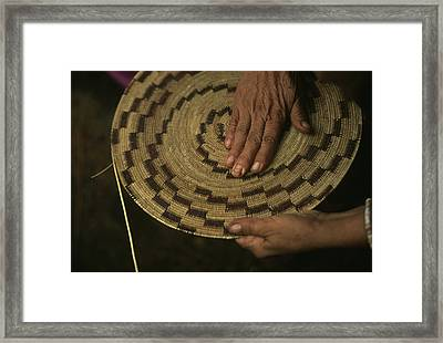 A Native American Basket Weaver Framed Print