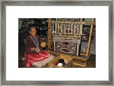 A Navajo Weaver At Her Loom Framed Print by David Edwards