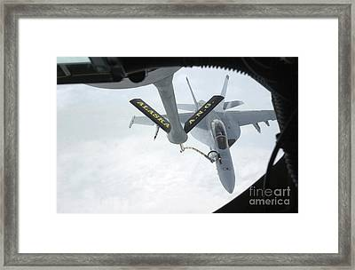 A Navy Fa-18f Super Hornet Is Refueled Framed Print by Stocktrek Images