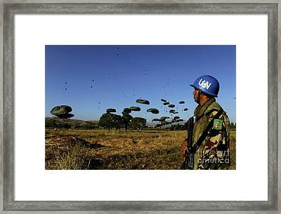 A Nepalese Service Member Watches Framed Print