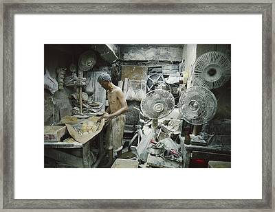 A Noodle Maker Works Covered In Flour Framed Print