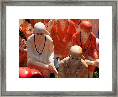 Framed Print featuring the photograph A Number Of Statues Of The Shirdi Sai Baba For Sale At Surajkund Mela by Ashish Agarwal