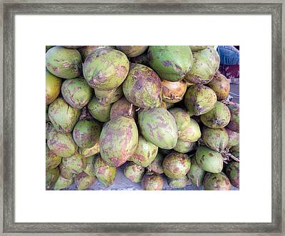 Framed Print featuring the photograph A Number Of Tender Raw Coconuts In A Pile by Ashish Agarwal