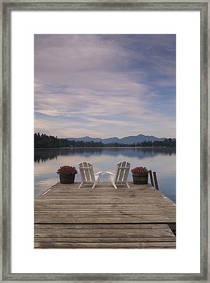 A Pair Of Adirondack Chairs On A Dock Framed Print by Michael Melford