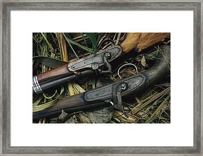 A Pair Of Old Flint-type Rifles Lying Framed Print by Steve Winter