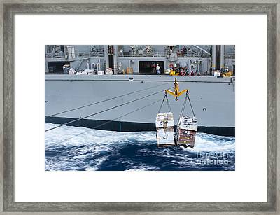 A Pallet Of Supplies Being Delivered Framed Print by Stocktrek Images