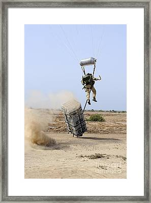 A Pararescueman Drops Into The Zone Framed Print