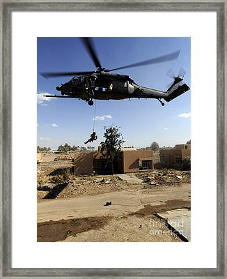 A Pararescueman Rappels From An Hh-60 Framed Print by Stocktrek Images