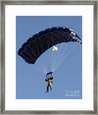 A Paratrooper Descends Through The Sky Framed Print by Stocktrek Images