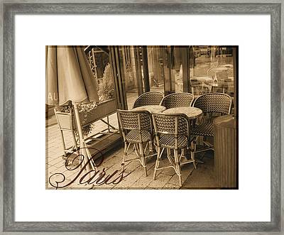 A Parisian Sidewalk Cafe In Sepia Framed Print by Jennifer Holcombe