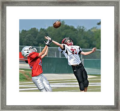 A Pass For The Touchdown Framed Print by Susan Leggett