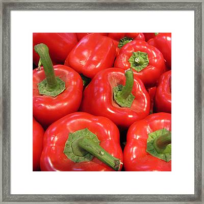 A Peck Of Red Peppers Framed Print by Kathy Clark