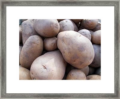 A Pile Of Large Lumpy Raw Potatoes Framed Print by Ashish Agarwal