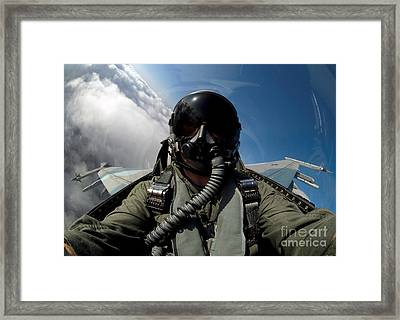A Pilot In The Cockpit Of An F-16 Framed Print by Stocktrek Images