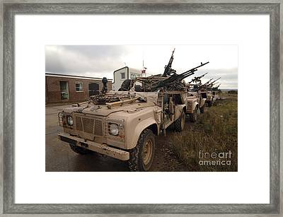 A Pink Panther Land Rover Framed Print by Andrew Chittock