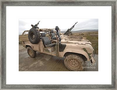 A Pink Panther Land Rover Desert Patrol Framed Print by Andrew Chittock