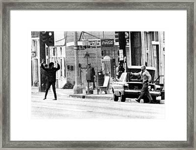 A Plainclothes Policemen Arrests An Framed Print