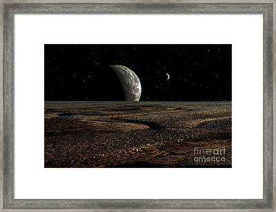 A Planet And Its Moon Are Dimly Lit Framed Print by Frank Hettick