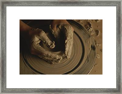 A Potter Makes A Pot From Clay Framed Print by Stephen Alvarez