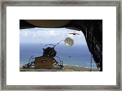 A Practice Pallet Is Released Framed Print by Stocktrek Images