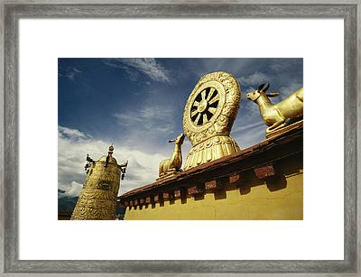 A Prayer Wheel, Deer And Wheel Framed Print by Justin Guariglia